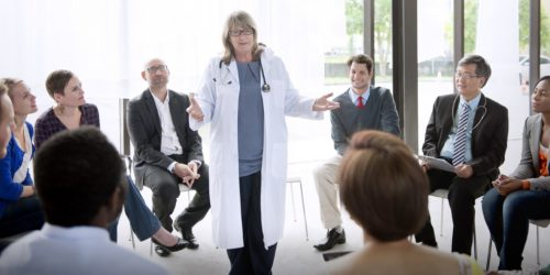 Doctor speaking to group
